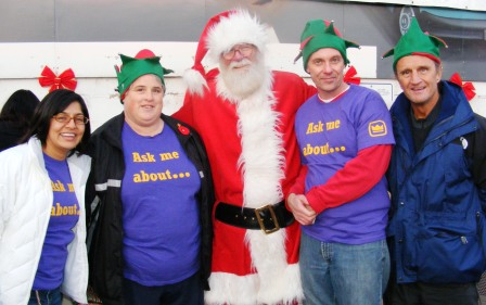Santa and some of his Crown Point volunteers (Image Credit: The Crown Jewel)
